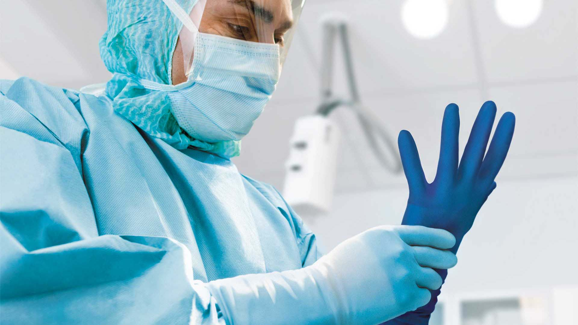 Surgeon using Biogel gloves with puncture indication